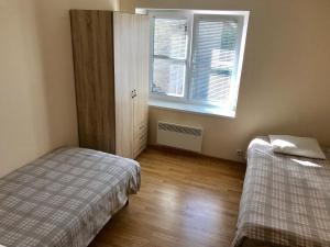 A bed or beds in a room at White House Apartment Kuressaare