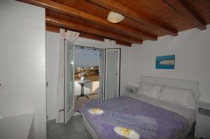 מיטה או מיטות בחדר ב-Lino Apartments