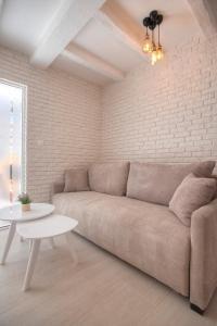 A seating area at Apartments Dzaleta