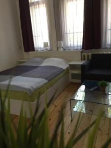 A bed or beds in a room at Apartment August 11