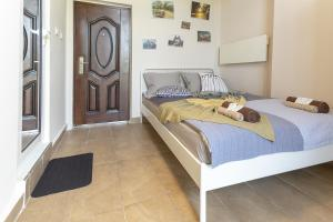 A bed or beds in a room at Gallery B11 Sofia Downtown Apartment