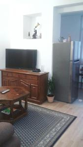 A television and/or entertainment center at Apartment Marsala Tita