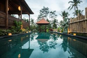 The swimming pool at or close to Kawan Antique Ubud Villa