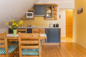 A kitchen or kitchenette at Apartments Sport Point