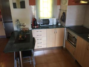 A kitchen or kitchenette at Ancora