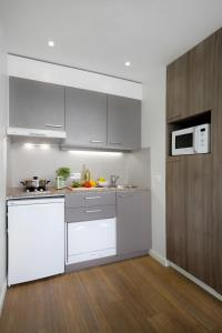 A kitchen or kitchenette at Citadines Toison d'Or Brussels Aparthotel