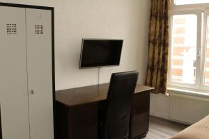 A television and/or entertainment center at Long Stay Bonjoere