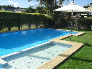 The swimming pool at or near Beachlander Holiday Apartments