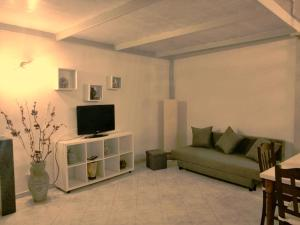 A seating area at Ciuciu Naples Apartment