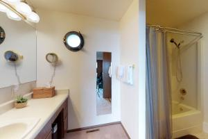A bathroom at Impressive Oceanfront Home