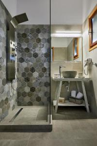 A bathroom at Mirabeli Apartments & Suites