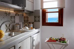 A kitchen or kitchenette at Mirabeli Apartments & Suites