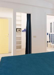 A bed or beds in a room at Residence Hotel Iselba