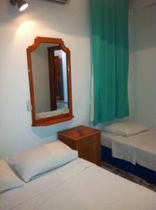 Кровать или кровати в номере Camyuva Turkuaz Apart Otel