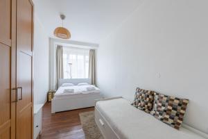 Ένα ή περισσότερα κρεβάτια σε δωμάτιο στο Falcon Apartment