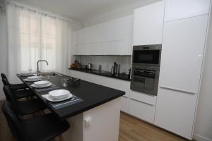 Küche/Küchenzeile in der Unterkunft L'ETOILE★LEYCAHOME