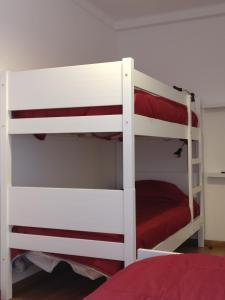 A bunk bed or bunk beds in a room at Casas do Megué