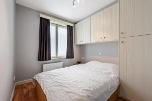 A bed or beds in a room at Leonetto