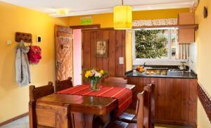 Un restaurant u otro lugar para comer en Solar de las Araucarias