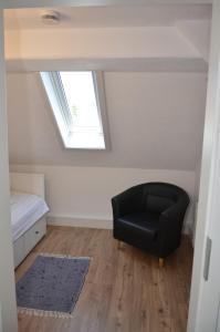 Ein Sitzbereich in der Unterkunft Ferienwohnung Lohra