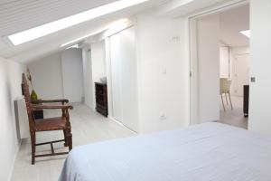 A bed or beds in a room at Bobia Apartment I