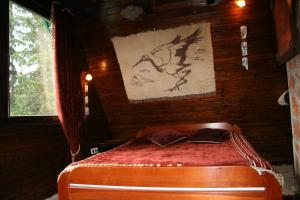 A bed or beds in a room at Durmitor Chalet