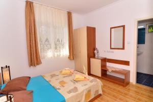 מיטה או מיטות בחדר ב-Royal Villas