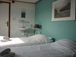 Appartementen aan den Hogeweg 객실 침대