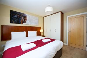 A bed or beds in a room at Staycity Aparthotels Saint Augustine Street