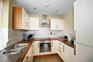A kitchen or kitchenette at Staycity Aparthotels Saint Augustine Street