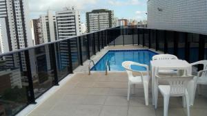 The swimming pool at or near Flat Recife