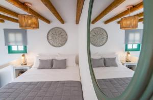 A bed or beds in a room at Babounis Suite