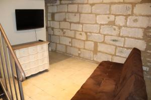 A television and/or entertainment center at Charme En Provence