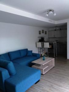 Ein Sitzbereich in der Unterkunft Apartments Fudel