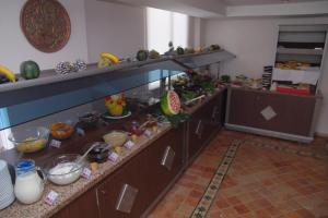 A kitchen or kitchenette at Atak Apart Hotel