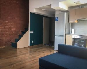 Гостиная зона в Apartments Vyborg