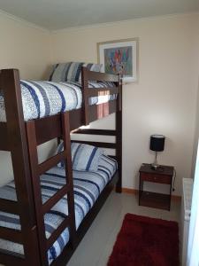 A bunk bed or bunk beds in a room at Departamentos Alejandro