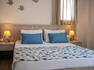 A bed or beds in a room at Evgoro Luxury Suites