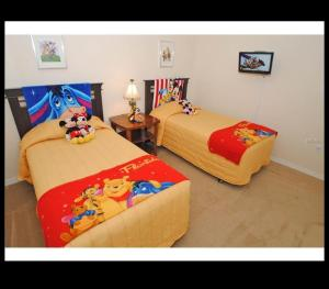 A bed or beds in a room at Orlando Discount Villas - Davenport