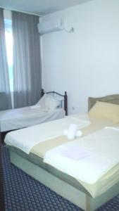 A bed or beds in a room at Apartment Marsala Tita
