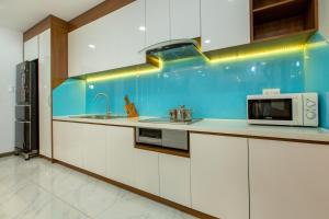 A kitchen or kitchenette at LUXURY GOLD APARTMENT 5 - Rooftop Pool City View In the HEART HCM 1207