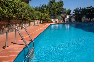 The swimming pool at or near Maison Vittoria