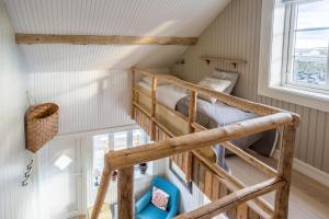 A bunk bed or bunk beds in a room at Sakrisøy Mini Apartment