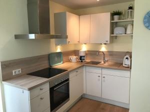 A kitchen or kitchenette at Beach Home