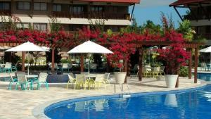 A piscina localizada em oka beach residence ou nos arredores