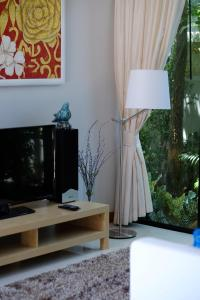A television and/or entertainment center at Peykaa Modern Villa