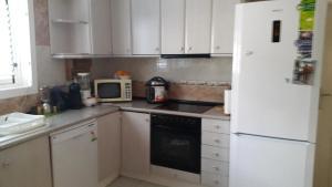 A kitchen or kitchenette at Villa Montecristo Ibiza