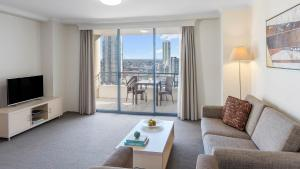 A seating area at Oaks Sydney Castlereagh Suites