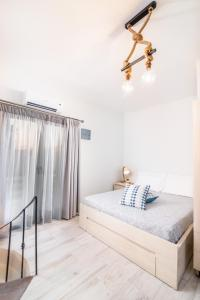 A bed or beds in a room at Ageliki Studio