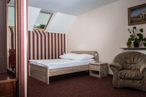 Łóżko lub łóżka w pokoju w obiekcie Prima
